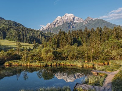 Scenic-sunrise-at-zelenci-spring-river-mountains