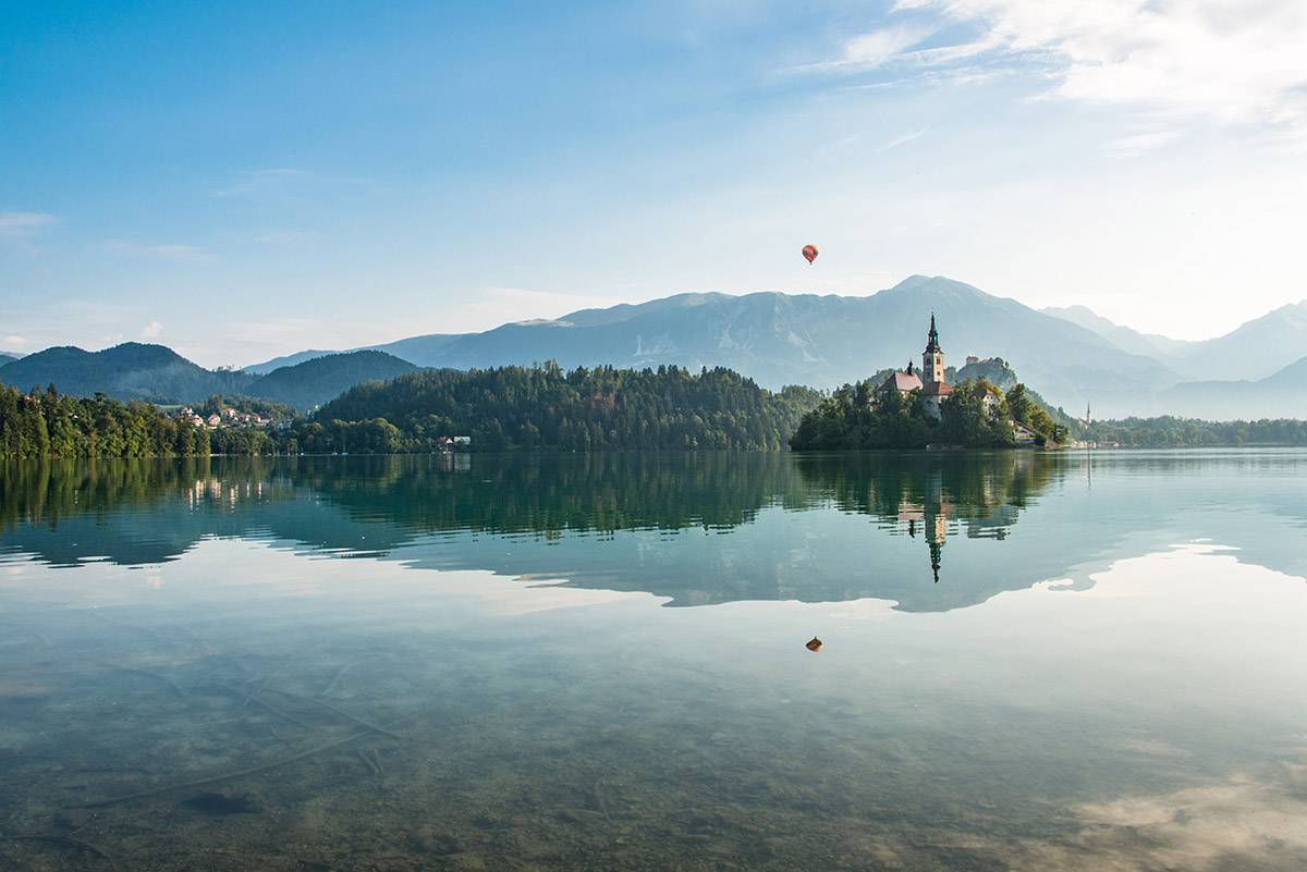 Amazing scenery at lake Bled with the balloon on hot air flying