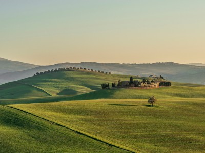 Tuscany farm at sunset