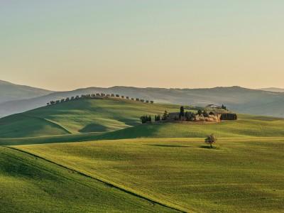 Tuscany farm at sunset