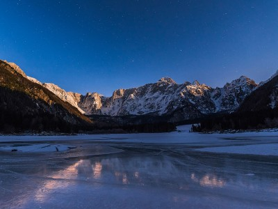 Reflections in the frozen lake at night