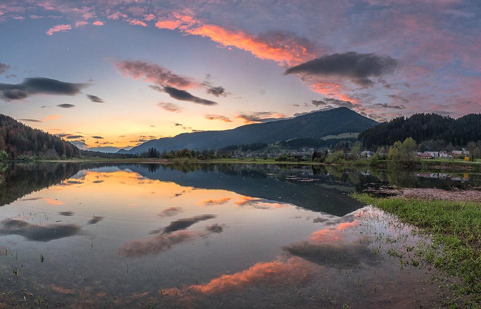 Vivid sunset at the lake, near Ratece village