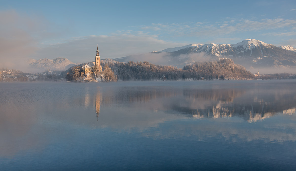 Winter image of lake Bled with Stol mountain on the right