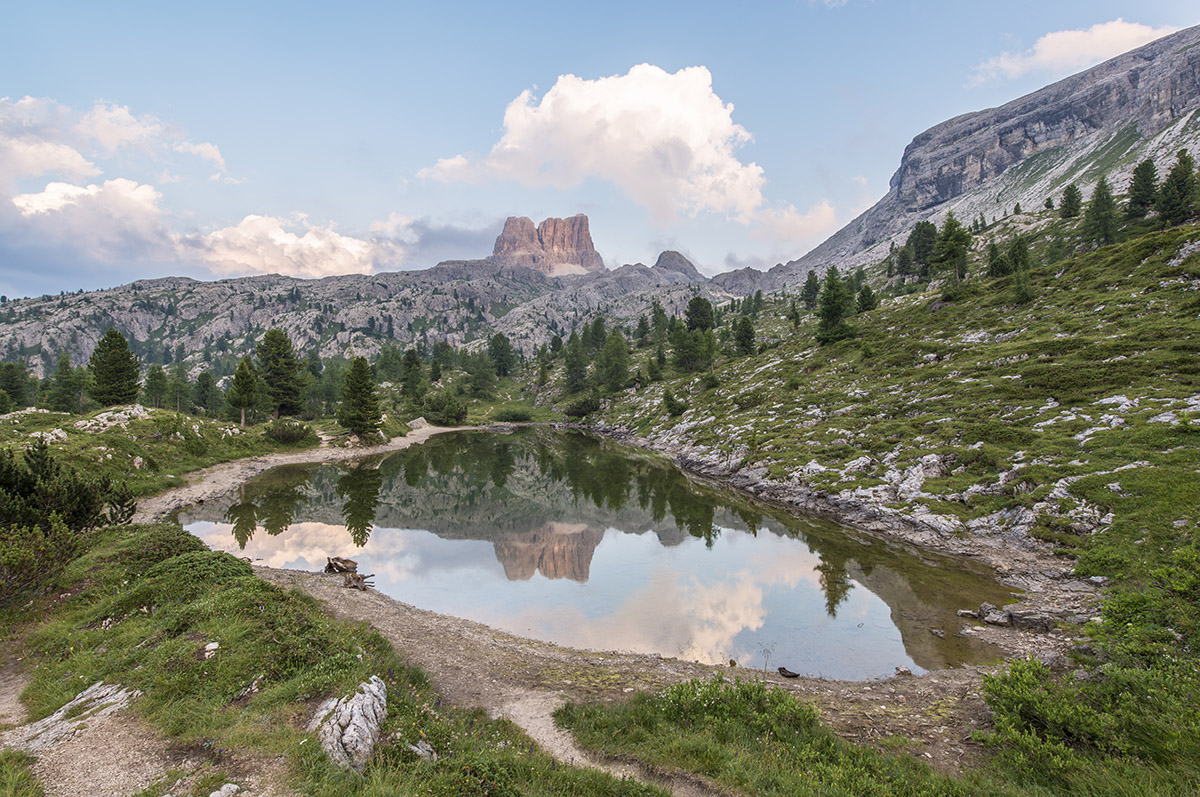 Fascinating reflections of the Dolomites mountains in lake Limed