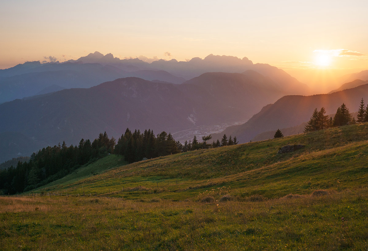 Sunset over the valley of the town Jesenice in Slovenia with hil
