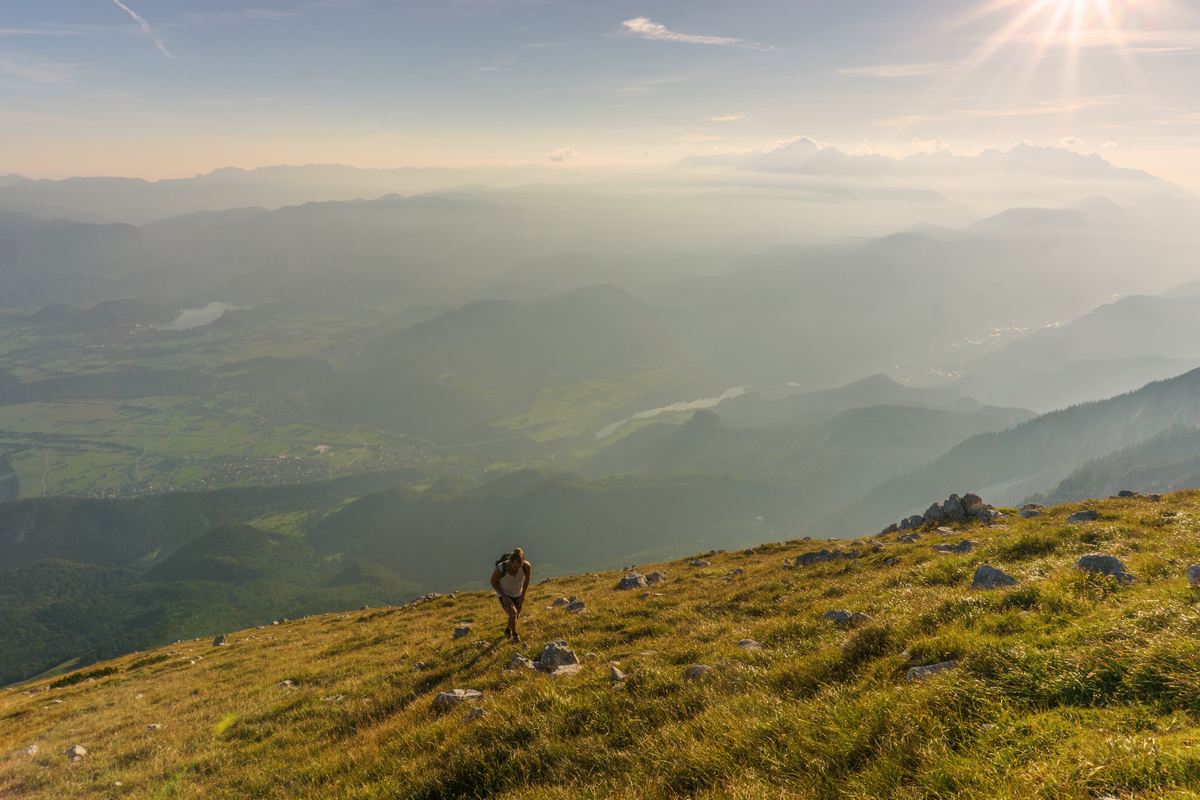 Male hiker on the way to the top of the mountain. Sport activity in Slovenia.