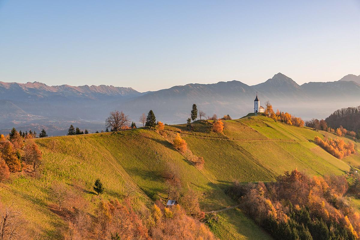 Church on the hill at sunrise. Beautiful scenery at Jamnik, Slov