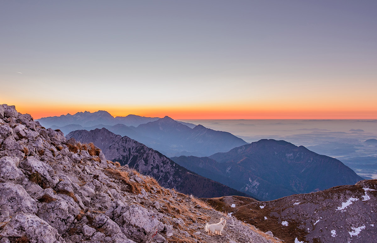 Beautiful romantic sunrise in the slovenian mountains. View of K