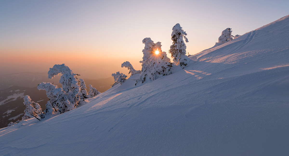 Sunset in the winter fairytale landscape.