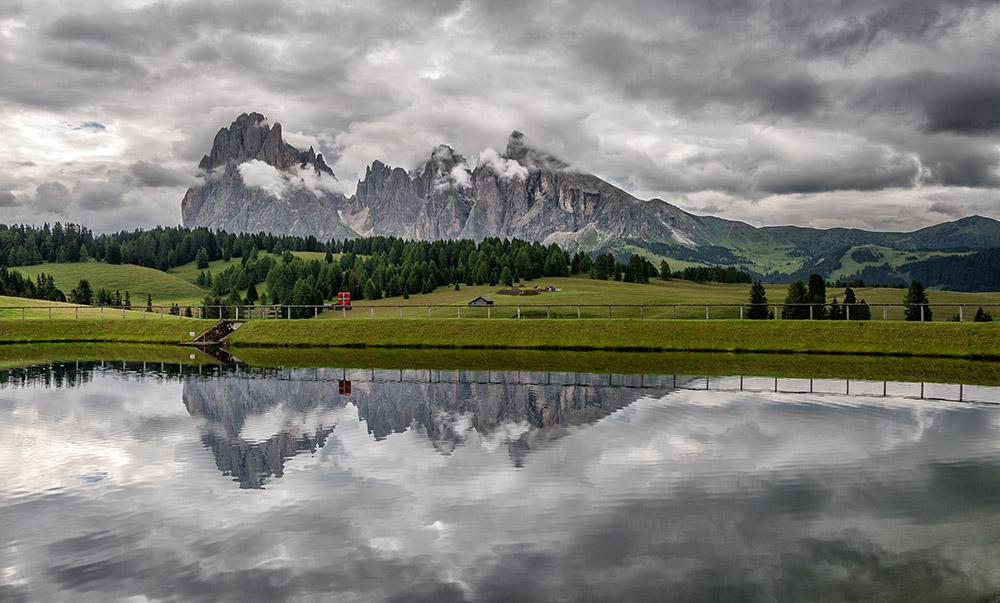 Dark and gloomy atmosphere at alpe di siusi in italian Dolomites.